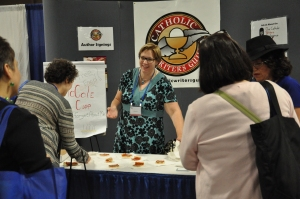 Author Erin McCole Cupp distributing slices of Philadelphia-style tomato pie at the 2013 Catholic Marketing Network Trade Show